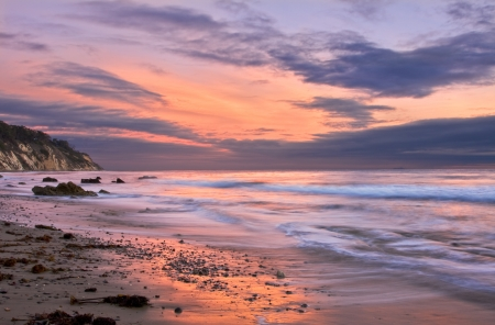 An ocean sunset at low tide in Santa Barbara California.