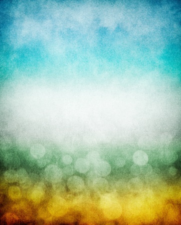 Fog, mist, and clouds with a yellow to blue gradient and boken effects.  Image has a pleasing paper texture and grain pattern visible at 100%.