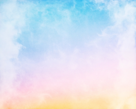 Foto de Fog and clouds on a colorful rainbow blue to orange gradient.  Image displays a pleasing paper grain and texture at 100%.  - Imagen libre de derechos