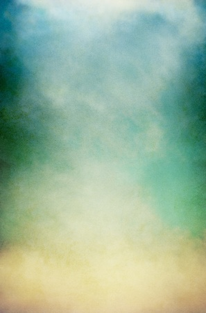 Fog, mist, and clouds on a vintage, textured paper background with a color gradient. Image has a pleasing paper grain pattern at 100%.