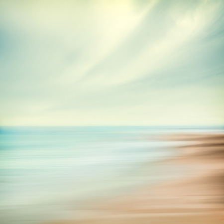 A seascape abstract with panning motion combined with a long exposure   Image displays soft, pastel colors in a retro style