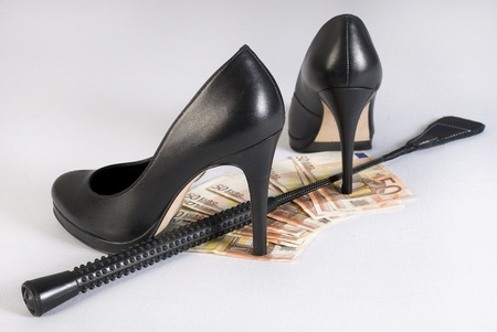 Leather Short Handle Crop, high heels and money over white background. Not isolated.