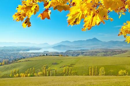Haj - Nicovo, beautiful autumn scenery overlooking the part of Liptovsky Mikulas with the backdrop of Liptovska Mara dam and Choの素材 [FY31089224343]