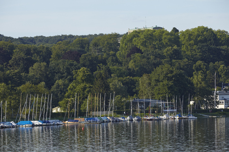 The Lake Baldeney (Baldeneysee) taken from the dam at Essen-Werden (Germany; Northrhine Westphalia) taken on July 31, 2015. The Villa Huegel (residence of the owner of former Krupp steelworks) is located at the top of the hill.