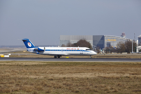 The Belavia Canadair CRJ-100ER with identification EW-100PJ takes off at Frankfurt International Airport (Germany, FRA) on March 18, 2016.
