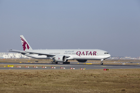 The Qatar Airways Boeing 777-3DZ(ER) with identification A7-BAJ takes off at Frankfurt International Airport (Germany, FRA) on March 18, 2016.