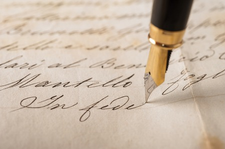 Fountain pen writing on an old handwritten letter