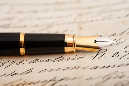 Fountain pen on letter background