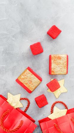Foto de Christmas background: shopping bags, gift boxes and gold stars. New year concept. Text space - Imagen libre de derechos