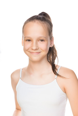 Foto de Beautiful smiling caucasian preteen girl in tank top with ponytail isolated on white. Studio portrait - Imagen libre de derechos