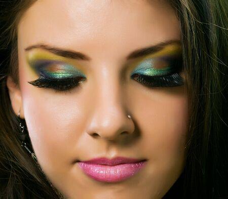 Closeup face with colorful beautiful makeup