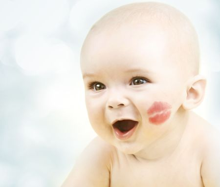 Happy smiling little baby with kiss