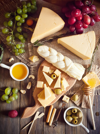 Cheese plate with various cheeses, grape and honeyの写真素材