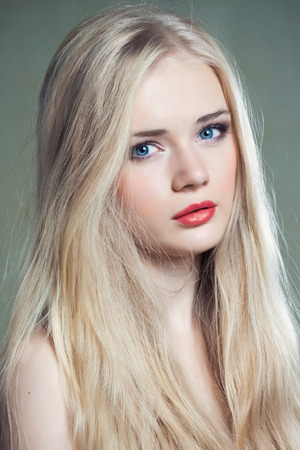 Beautiful girl with blue eyes and long blonde hair