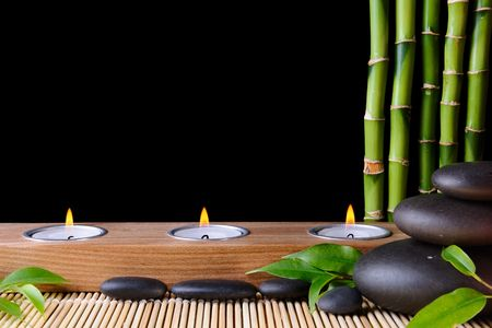 Bamboo,zen stones and candlestck on the black background