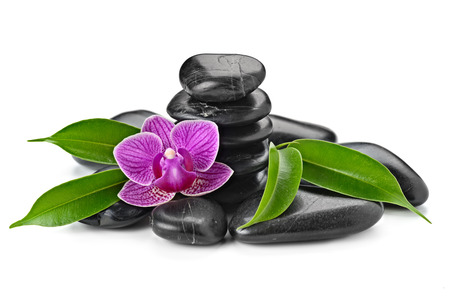 zen basalt stones and orchid isolated on whiteの写真素材
