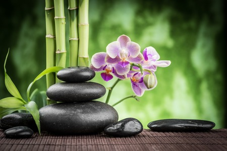 Photo pour zen basalt stones ,orchid and bamboo - image libre de droit