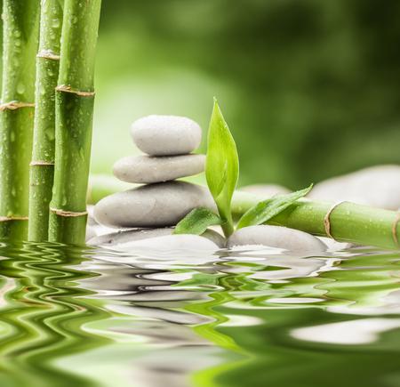 Photo pour zen basalt stones and bamboo - image libre de droit