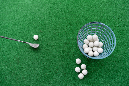 Photo pour Golf club and balls on a synthetic grass mat at a practice range. - image libre de droit