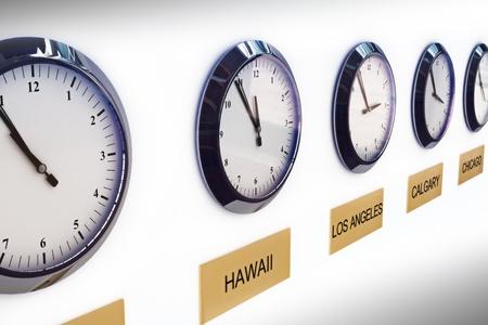 Foto de Timezone clocks showing different times of world locations  - Imagen libre de derechos