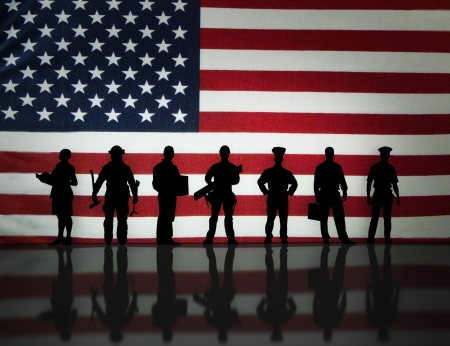 American workers silhouette with an American flag background