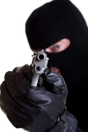 Masked man with handgun shot on white background.
