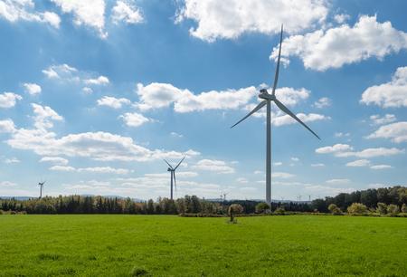 Photo pour Wind turbines in a field - image libre de droit