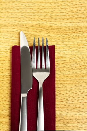 Knife and fork on red napkin