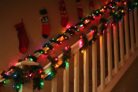 Lovely banisters decorated with Christmas garland and lights