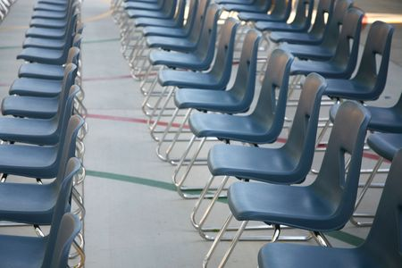 Row of blue chairs ready to hold an event