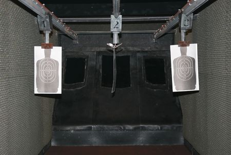 Mobile transportation of an indoor police target shooting range for qualifying