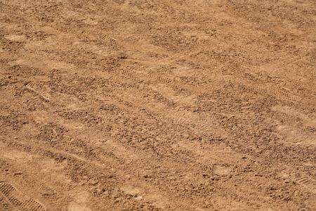 Natural texture background of dirt with footprints