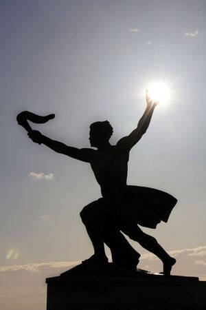 Young man with a sun in his hand and a torch in the other: part of the Liberation monument on the top of Gellert Hill in Budapest (lucky shot!)
