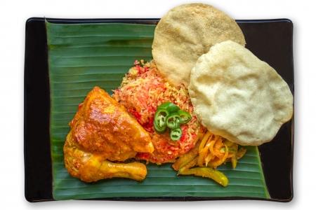 Indian traditional food, Briyani Rice served on banana leaf