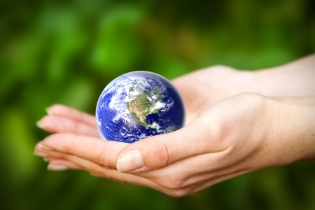 human hands carefully holding Earth planet  Glass Worldの写真素材