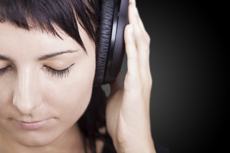 Young woman with headphones, enjoying nice music