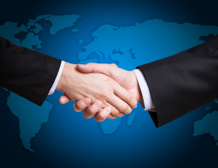 Closeup of a business hand shake between two colleaguesの写真素材