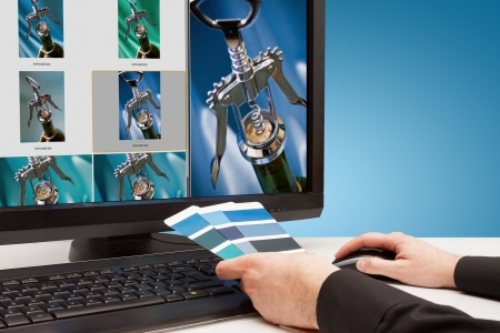 Graphic designer at work  Color samples blue  Select photos picture