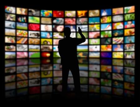 Photo pour Back view of a young man watching a big TV panel - image libre de droit