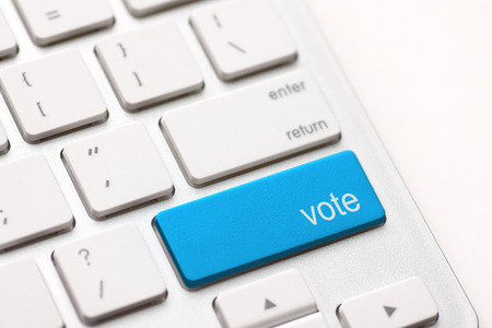 democracy concept with vote button on keyboard