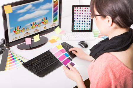 Photo pour Graphic designer at work  Color swatch samples  - image libre de droit
