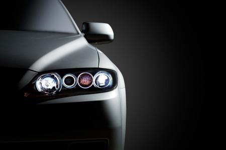 Gray modern car closeup on black background