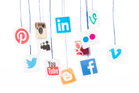 Photo for BELCHATOW, POLAND - AUGUST 31, 2014: Popular social media website logos printed on paper and hanging on strings. - Royalty Free Image