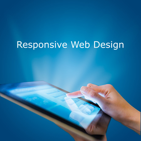 Responsive web design on mobile devices tablet pc on blue background