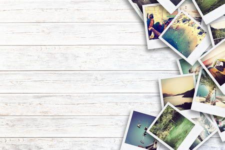 Photo pour Frame with old paper and photos. Objects over wooden planks. - image libre de droit