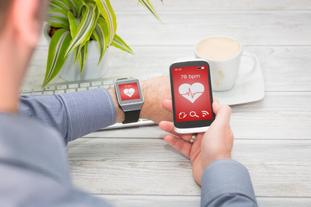 Businessman uses smart watch and phone. Smartwatch concept.