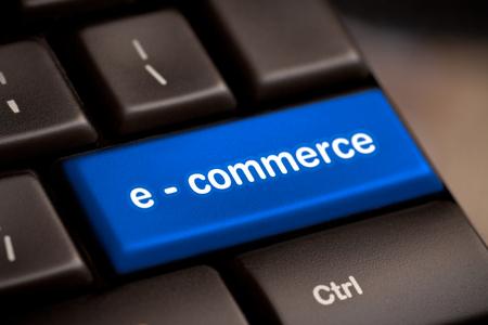 Photo pour Computer keyboard with e commerce key. - image libre de droit