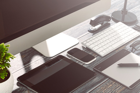 Designer's desk with responsive design mockup concept.