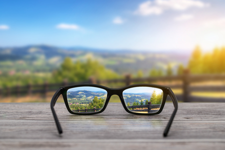 Photo pour glasses focus background wooden - stock image - image libre de droit