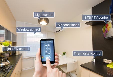 Photo pour Remote home control system on a digital tablet or phone. - image libre de droit